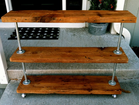 More industrial minimalist decor... Perhaps I need to invite my husband to Pinterest after all... lol rustic utility cart made with salvaged wood and piping! oh the possibilities!