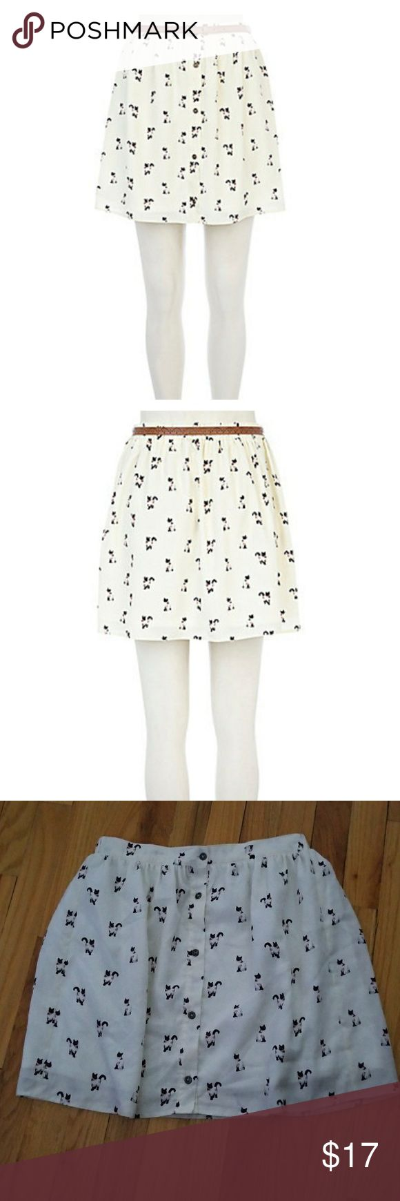 """River Island Cat Button-down Skirt River Island Cat Button-down skirt. Cats adorn the entire skirt, front and back. Size 6 US (UK 10). Cream color. Button-down in front. Fully lined. Does not come with brown belt. Elastic on back of skirt at waist. See last pic of little mark (stain - unsure if it will come out, didn't try). 14"""" waist laying flat. 16.5"""" length. Flowy. Great condition otherwise. River Island Skirts"""
