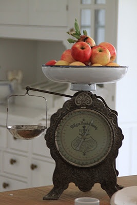 Photo Gallery Website Strikingly colorful apples on an old fashioned scale against a sea of neutrals French cottage style