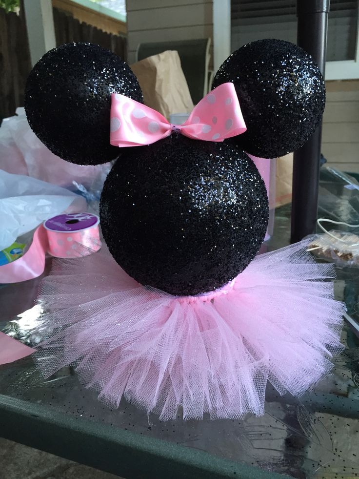 Minnie Mouse styrofoam head painted black and glittered with pink tutu skirt.