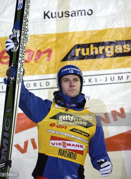Finland's Janne Ahonen celebrates on the podium after winning the second round of the World Cup ski jumping in Kuusamo 28 November 2004 Austria's...