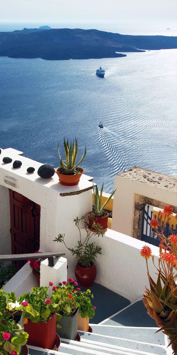 Volcano view from Fira, Santorini, Greece. For luxury hotels in Santorini visit http://www.mediteranique.com/hotels-greece/santorini/