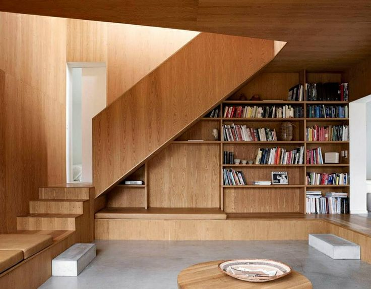 Stairs behind wood panel bookshelfs stairs pinterest - Staircases with integrated bookshelves ...
