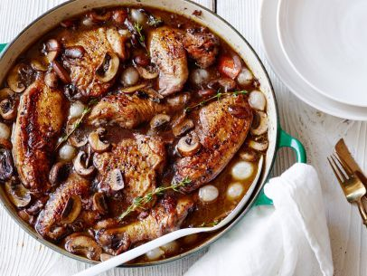 Recipe of the Day: Classic Coq Au Vin Ina's method for the French classic coq au vin, chicken cooked in wine, is easier than the more extensive French method (i.e., it doesn't involve, uh, lighting the cognac with a match). But it stills results in that distinctively rich, iconic flavor, thanks to crispy bacon, flavorful cremini mushrooms and dry red wine.
