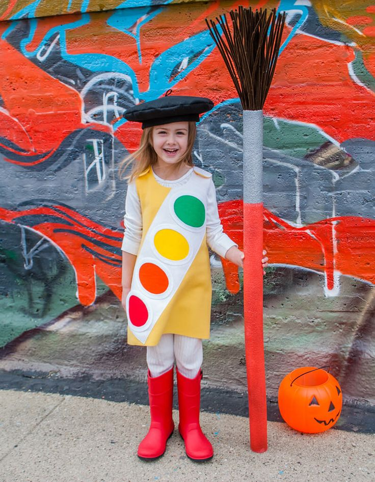 DIY kids Halloween costume idea: Watercolor Paint Box, topped with a handmade French-inspired beret and a jumbo paint brush made from a pool noodle. It's simple and clever with just a little sewing required for your little artist.