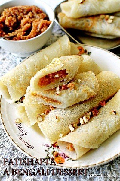 Patishapta (A Bengali Dessert), rice flour pancakes with ...