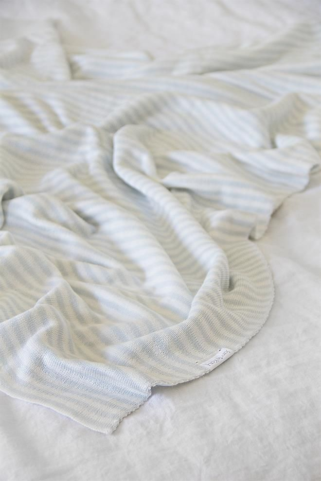 Jamie Kay Bamboo Cotton Stripe Cot Blanket/Wrap  Size: 130cm by 100cm  Beautiful soft blue and off white stripe.  Reversible Stripe.  Silky soft 70% bamboo 30% cotton.  Styling Tip:  Cot size is perfect for adding a bit of charm to the arm of the couch.  This product can also be doubled over for a bassinett blanket.