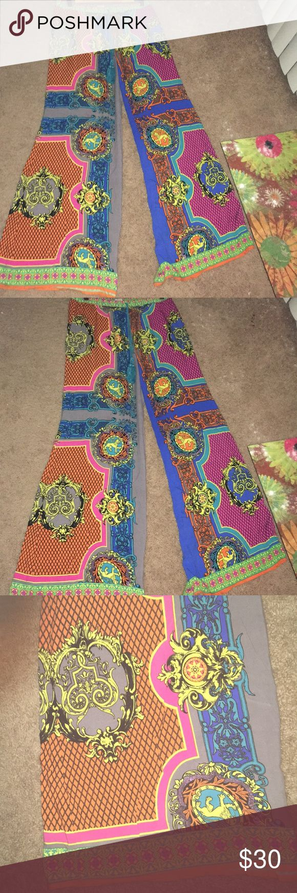 Funky and fab pair of Flying Tomato soft pants! These pants are amazing!  The colors and patterns make these pants go with everything!  Soft for lounging. I wore these cool pants on the beach in Miami. Perfect for stashing in your beach bag or just watching a movie!! Flying Tomato Pants Wide Leg