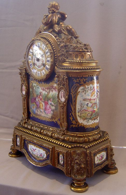 Exotic antique Clocks   Antique French porcelain and ormolu mantle clock with painting after ...