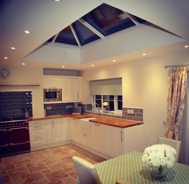 Wren Living - Country Cream and Oak Kitchen designed by Conor in our Reading store - we absolutely love that skylight! The spotlights bordering it are a really smart touch, too.