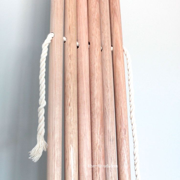 DIY Kids teepee - Threading the rope to tie poles together