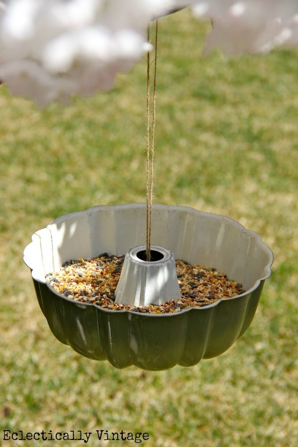 Bundt Pan Bird Feeder: to hang it wrap twine around a tennis ball and put underneath the pan, bring the two ends of twine through the top and tie onto the tree.