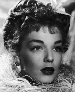 I was described as a young Simone Signoret in my modelling days.