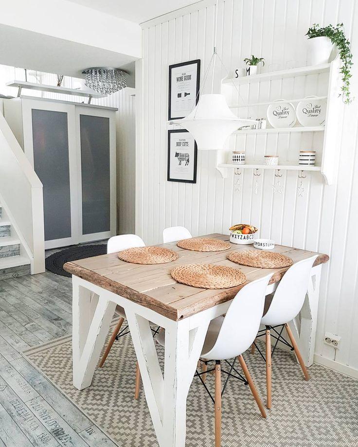 Puinen ruokapöytä antaa tilaan kivan ripauksen maalaisromanttista tunnelmaa.