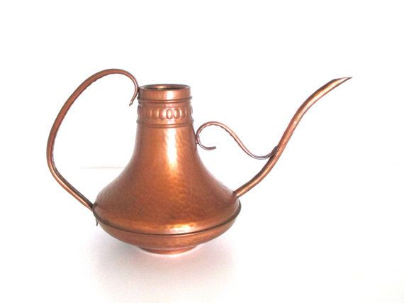 Can you say stunning? Midcentury hammered copper watering can