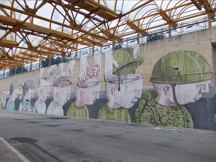 """Street artist Blu has composed an anti-war mural for festival """"Draw The Line"""" in Campobasso, Italy."""