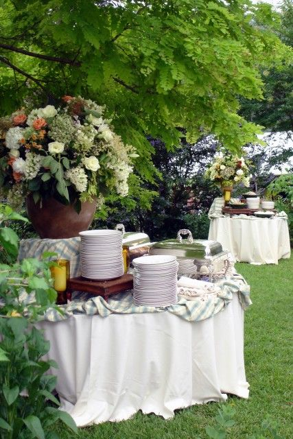 Two outdoor buffets for a late June wedding reception on The Guest House Lawn