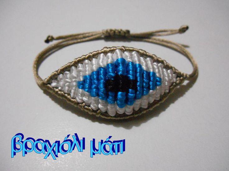 beige/white/turquoise evil eye