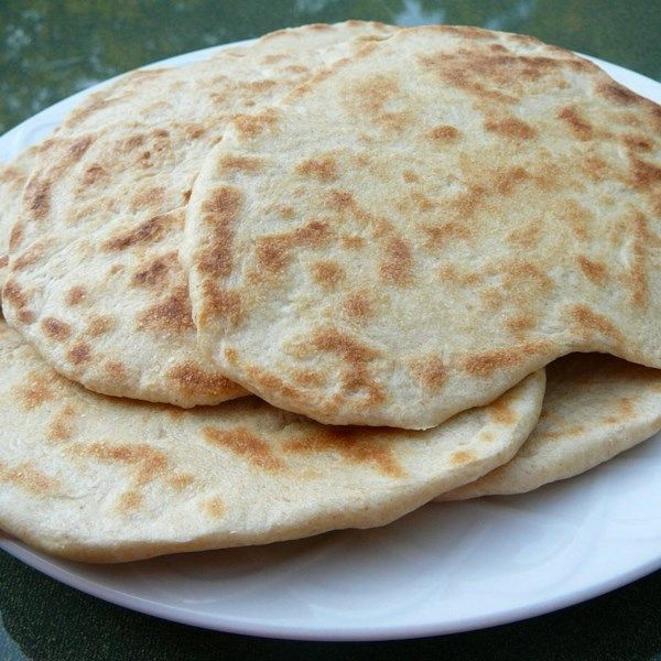 "Syrian Bread | ""Mix the dough in your bread machine and bake in the oven. A versatile Middle Eastern style flat bread that you can serve with lunch or dinner."" #recipe #entertaining #holidays"