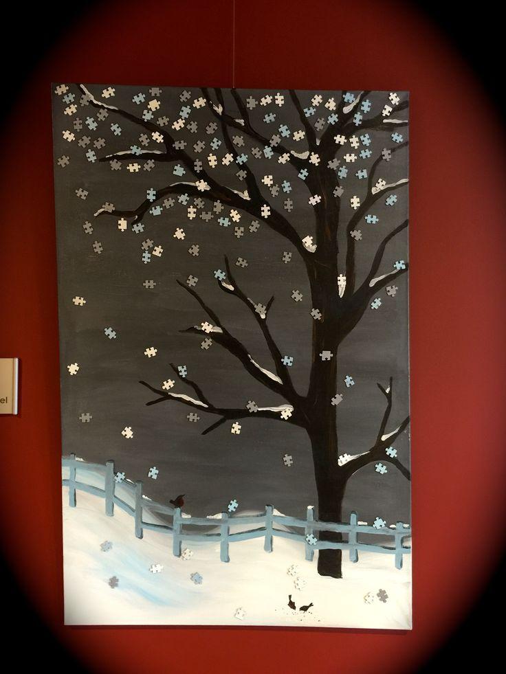 Winterlandschap met geverfde puzzelstukjes