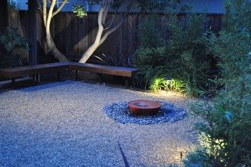 Gravel courtyard with Feng Shui landscape. I like the use of gravel instead of bark dust, and some king of water feature. Here, a small red or copper colored fountain tucked away at ground level completes the five elements of feng shui present in the garden: wood, fire, earth, metal and water.