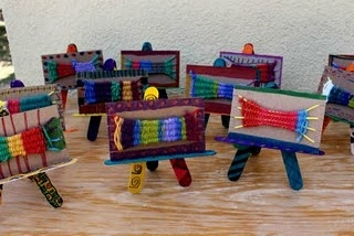 I like how the weavings are displayed on popsicle stick easels...neat idea.