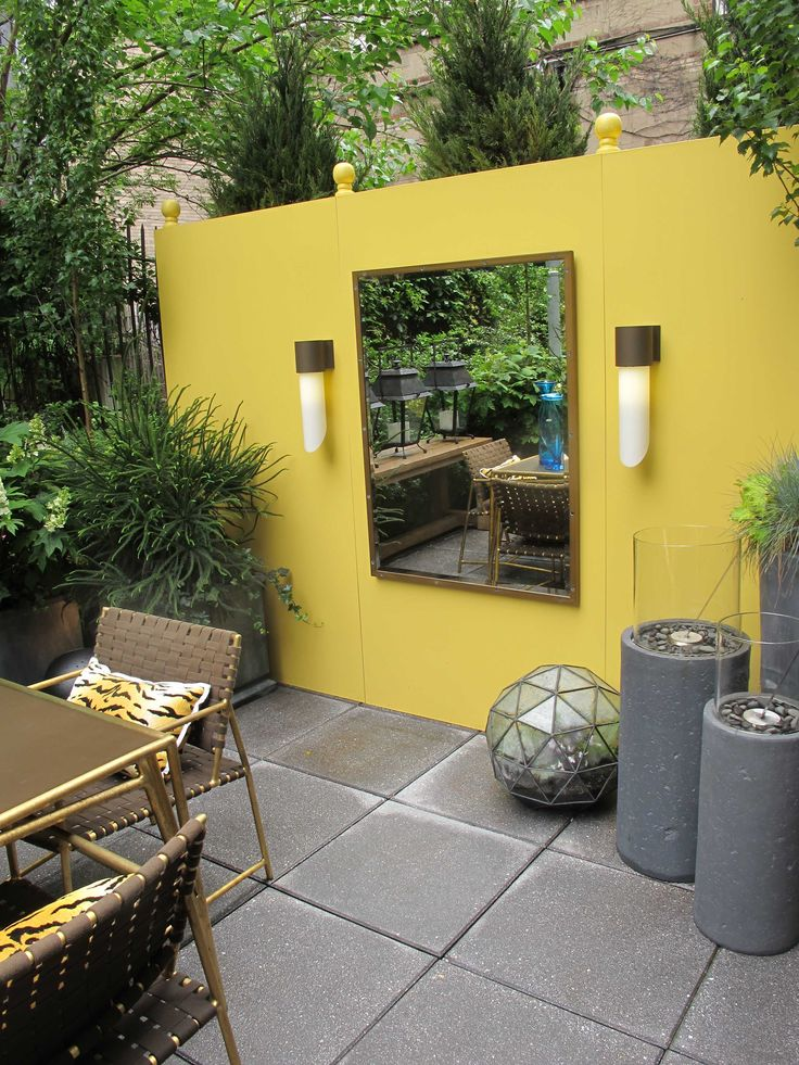 Yellow wall at Elle Decor Modern Life Concept House: Life Concept, Concept House, Courtyards Wall, Backyard Ideas, Elle Decor, Basements Wall, Decor Modern, Courtyards Yellow Wall, Outdoor Spaces
