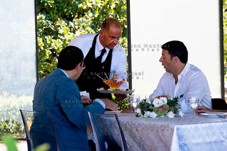 The meeting of the two mayors of Rome and Florence, Ignazio Marino and  Matteo Renzi, in Rome with a visit to the Roman Forum and the Capitoline Museums. A waiter serves an appetizer at the restaurant on the terrace Cafferelli