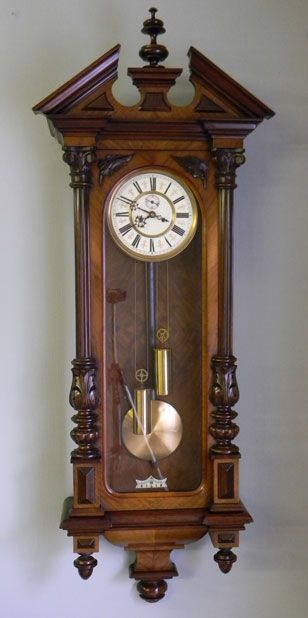 Antique Walnut Vienna Wall Clock Antique 19th Century Vienna Regulator Figured Walnut Double Weight Wall Clock having Shaped Pediment with Turned Finial in the Centre Striking the Hour & Half Hour on a Coiled Gong 8 Day Duration