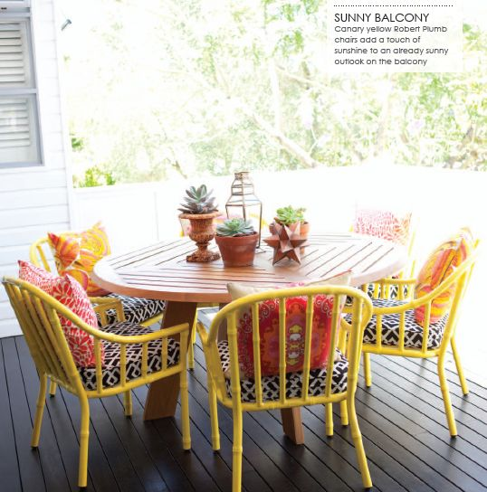 Beautiful outdoor dining set, love the yellow chairs!