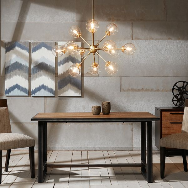 The Paige chandelier pulls inspiration from the Sputnik lights that adorned many homes at the height of Mid-Century Modern style. Illuminate any space, from your dining room, entryway, or bedroom, wit