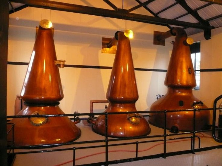 Auchentoshan still room    Scotch malt whisky is usually distilled twice in pot stills . There are some exceptions: Auchentoshan and Hazel...