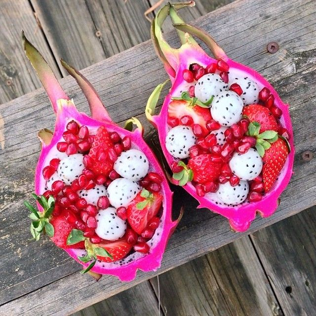 """Check out these fruit bowls! This one is dragon fruit """"bowls"""" filled with dragonfruit, strawberries, & pomegranate!"""