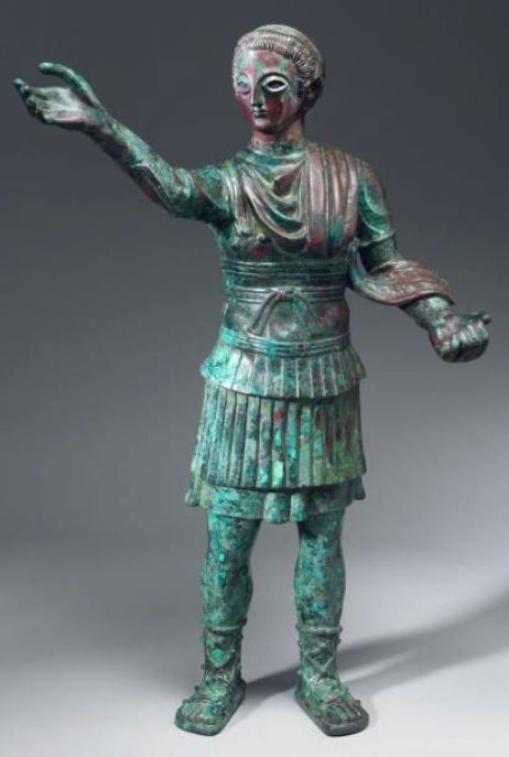 Macedonian Style Bronze Figurine from the Arabian Peninsula, c. 3rd-1st Century BCThis is believed to be a statue of a special representative welcoming a king. He wears a chitoniskos (tunic) with a...