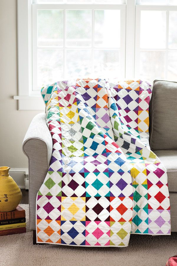 "Designer Thomas Knauer loves adding bits of color to the corners of squares, and then creating new shapes when the blocks are sewn together. This fat quarter friendly quilt features each color of your stash perfectly in 6"" quilt blocks."