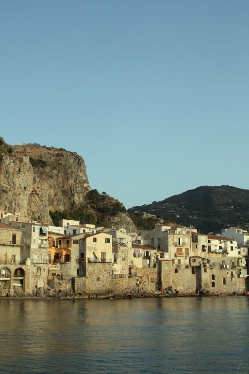 Cefalu, I've been here and climbed on those rocks against the water, and I climbed up to the top of that plateau. Beautiful. Perfect.