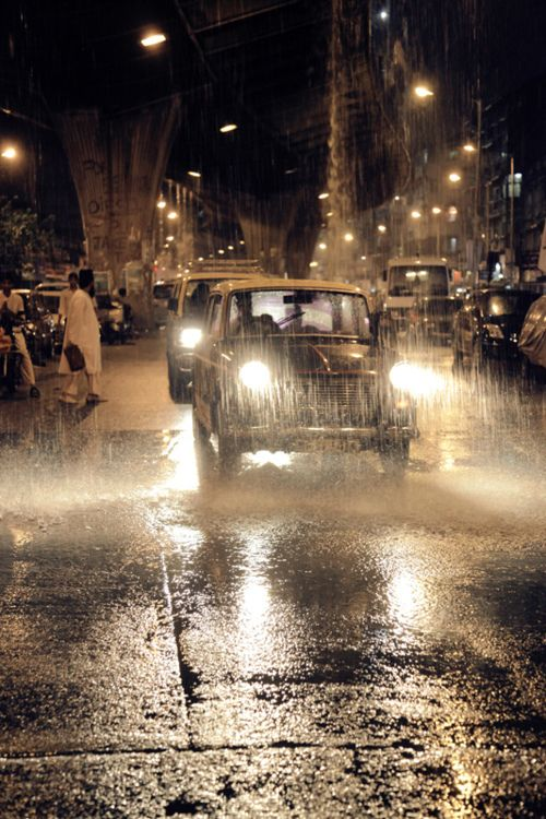 """Mumbai: """"I awake to find rain lashing against the windows of the hotel. Looking down I can see that the road at the entrance below is flooded. Taxis are ploughing through the water, sending spray in all directions, and hotel staff are dashing out into the rain with umbrellas. The promenade is almost deserted, although a few stalls are still manned by drenched figures in shorts, flip flops and yellow tarpaulins."""" Fakirs... www.bradtguides.com"""