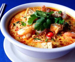 Seafood Laksa soup.Spicy soup from Malaysia and Indonesia.It is enriched with coconut cream and includes seafood and rice noodles.