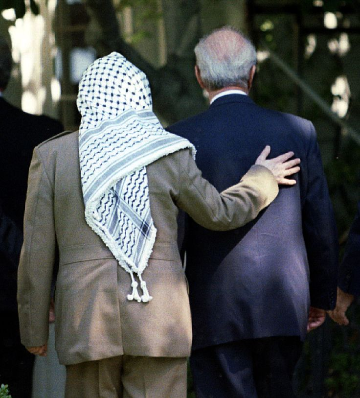 PLO chairman Yasser Arafat (l) puts his arm around Israeli Prime Minister Yitzhak Rabin as they enter the  White House on Sept. 28, 1995 prior to the signing of an Israeli-PLO accord. (Reuters)