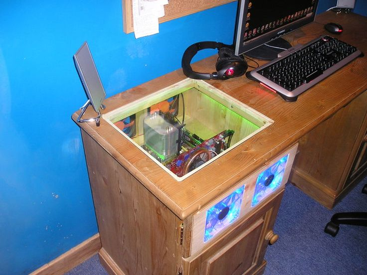 Computer built into desk; with a wood top panel and a decorative grate in front of the fans, this would be perfect