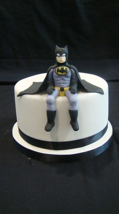 I'm sorry..but it looks like he's going to the bathroom on the cake??? ... my pins have been less than useful tonight. :(