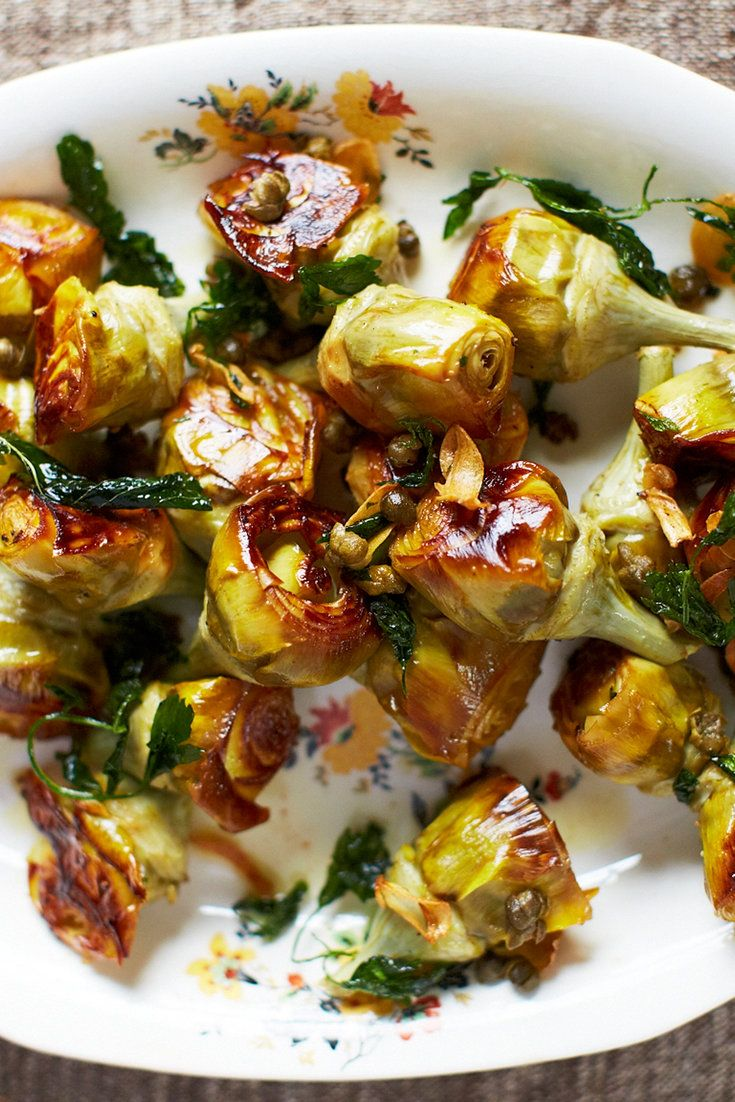 """NYT Cooking: This beautiful recipe for pot-roasted artichokes with white wine and capers appears in the chef April Bloomfield's 2015 cookbook """"A Girl and Her Greens."""" It's tremendous. """"The fleshy artichokes get browned and crispy tops and look like strange, beautiful roses,""""  she writes. """"The acidity in the white wine cuts through the rich, dense veg and, along with the salty pops from..."""