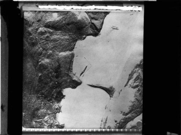 Sep 22 1943 X craft – midget submarine – attack on the Tirpitz - See more at: http://ww2today.com/22nd-september-1943-x-craft-midget-submarine-attack-on-the-tirpitz?An aerial reconnaissance photograph of Alten Fjord showing the German battleship TIRPITZ at her anchorage where the Tirpitz was attacked and...
