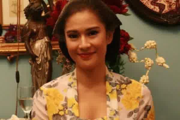 She is very beautiful. Isn't she?