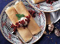 Spicy, sweet cardamom flavors the rich cream tucked inside of these light, tender crepes.  This breakfast or dessert treat has an international flavor you'll love.