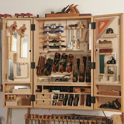 "A Cabinet for Hand Tools.  Fine Woodworking.  Pretty close to what I want, but with more drawers and less plane ""cubbies"" along the bottom."