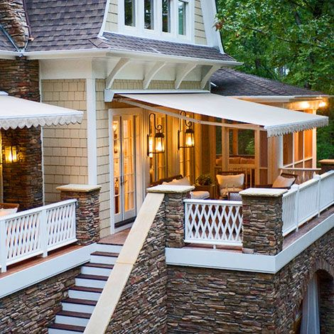 Retractable awnings provide sun protection and create additional outdoor living space.