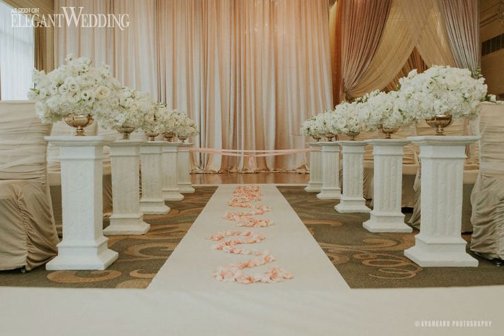 Luxurious White Wedding With Aisle Lined Up With Lush