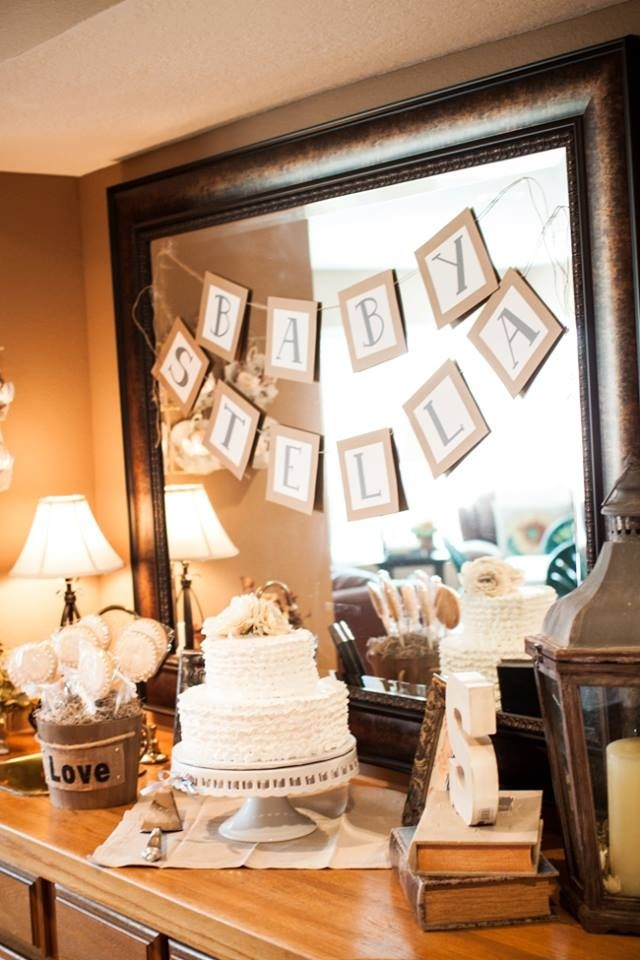 Feeling this rustic look for a Baby Shower. Instead of using the traditional pastel colors, WE LOVE the use of Browns and flesh tone shades :)