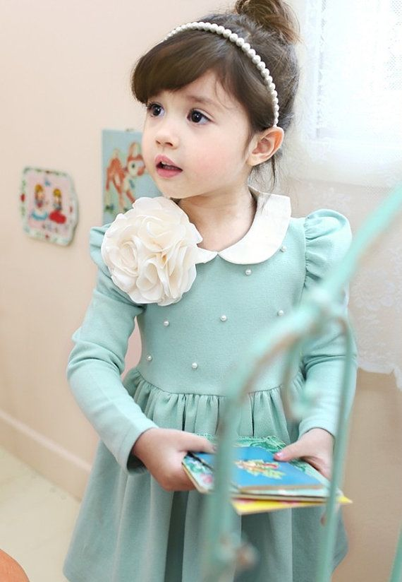 Long sleeved pearl dot dress for baby girl, toddler and kids. I dont like the flower though. But love the dress.